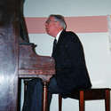 Dr, Boughen at the piano