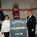 Fern and Mike Lipiski with the Elderberries Banner